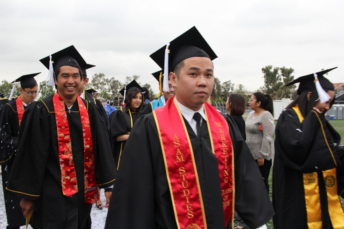 Excited AAAS Students Walking to Commencement