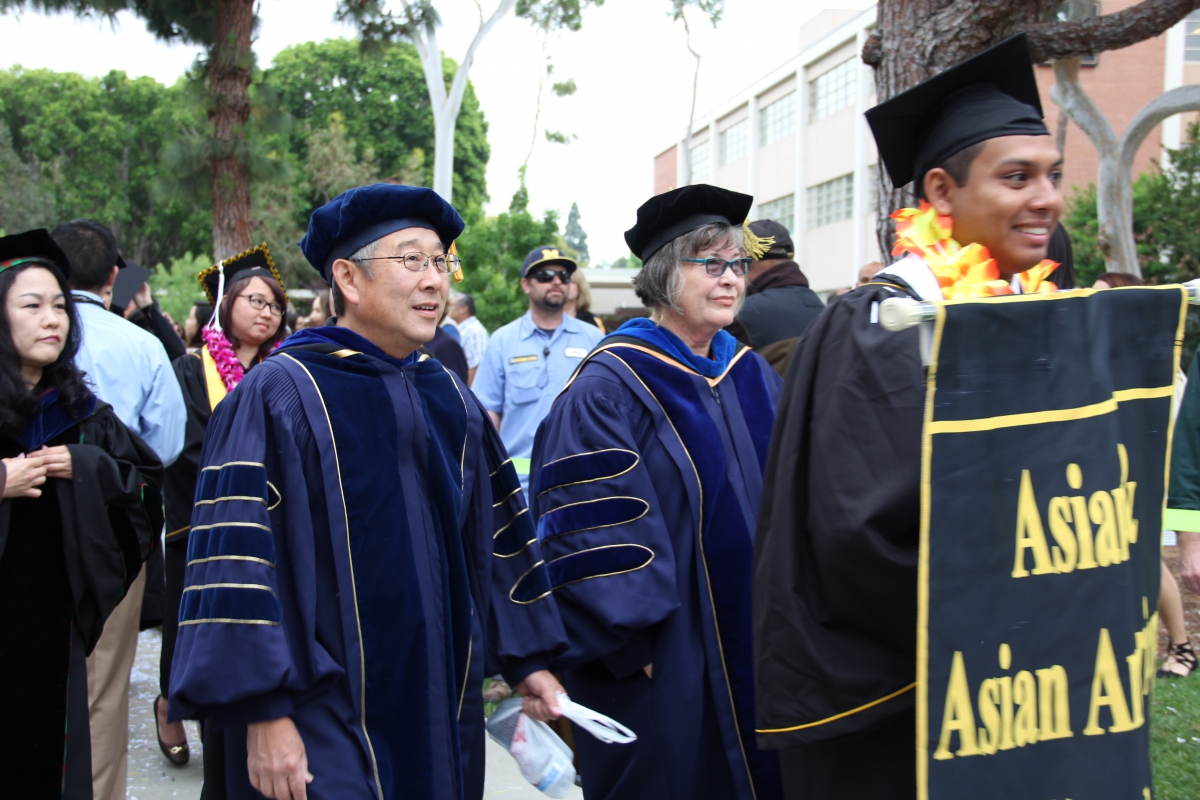 AAAS Faculty Marching with Department Banner