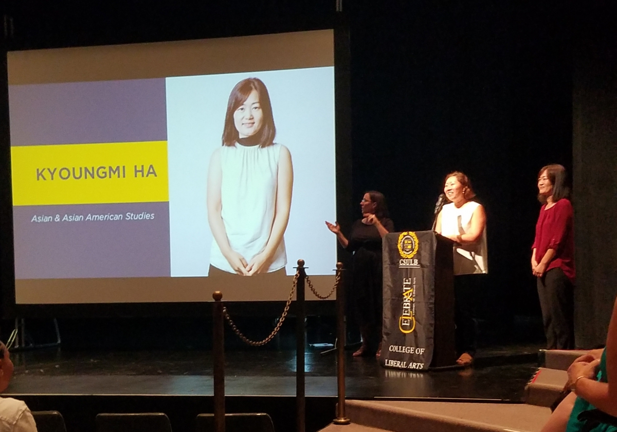 Dr. Barbara Kim introduces new Assistant Professor Dr. Kyoungmi Ha during CLA Convocation